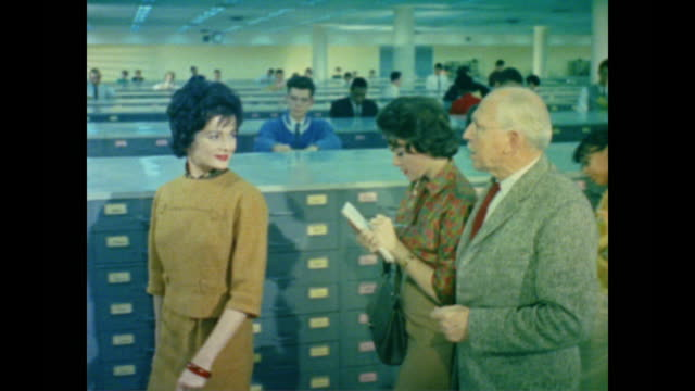 1962 staff use social security cards to check original application files in ssa home office - 社会保障点の映像素材/bロール