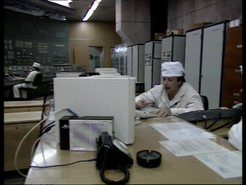 Staff working in the reactor control room of Chernobyl nuclear power plant Ukraine 1990's