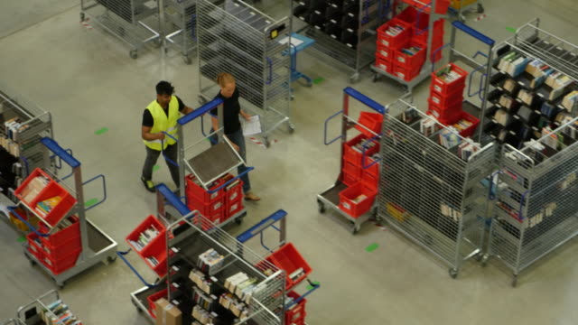 Staff working on a warehouse building