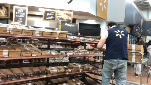 stockvideo's en b-roll-footage met staff working on bakery at walmart super shopping center in north georgia usa - wal mart