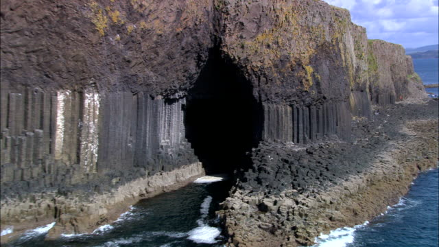 staffa and fingal's cave  - aerial view - scotland, argyll and bute, united kingdom - cave stock videos & royalty-free footage