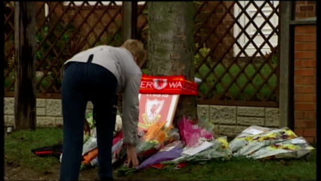 staffordshire lichfield ext woman laying flowers with other floral tributes for eccles and messages on cards - lichfield stock videos & royalty-free footage