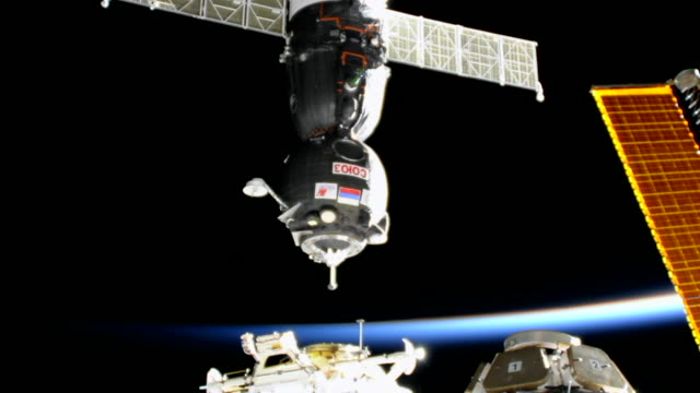 stockvideo's en b-roll-footage met the docking to the iss process the planet earth horizon can be seen in the distance the progress ms05 is known by nasa as the progress 66 or 66p the... - ruimtemissie