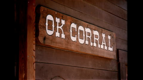 vídeos y material grabado en eventos de stock de / staged gunfight at the ok corral at corriganville ranch / actors in western clothes, crouched and shooting on western film set / stuntmen fall from... - western usa