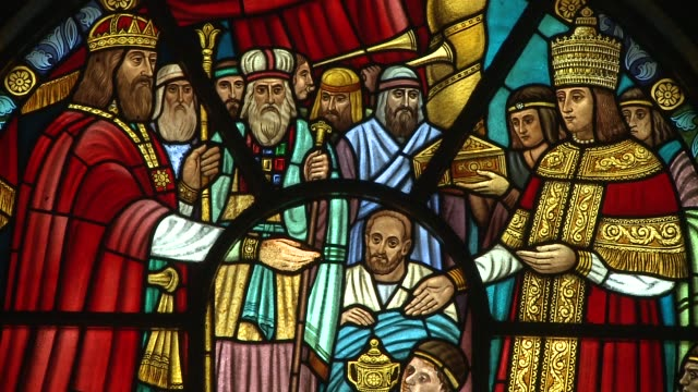 a stained glass window depicts a group of robed kings and saints. available in hd. - ceremonial robe stock videos and b-roll footage