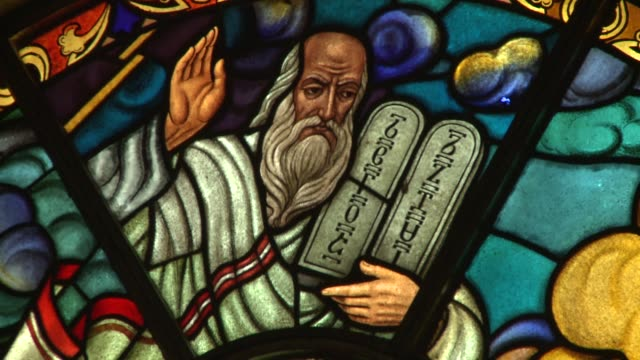 a stained glass window depicts moses holding the ten commandments tablets. available in hd. - bible stock videos & royalty-free footage