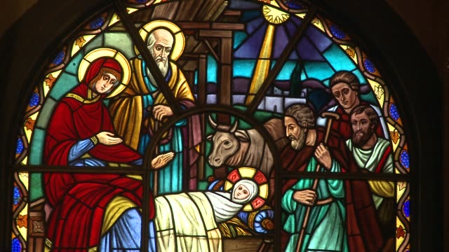 a stained glass window depicts the birth of jesus. available in hd. - new life stock videos & royalty-free footage