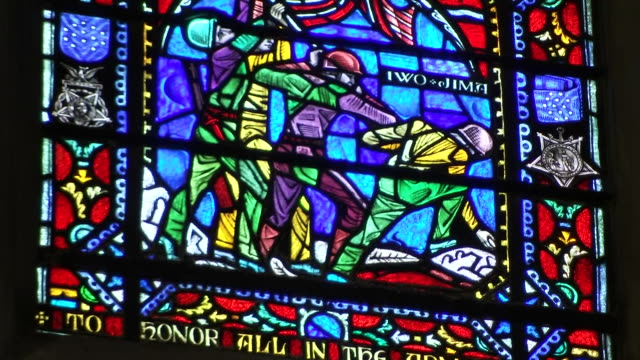 stockvideo's en b-roll-footage met a stained glass window honoring the armed forces inside of the washington national cathedral on september 31 2018 - religion or spirituality