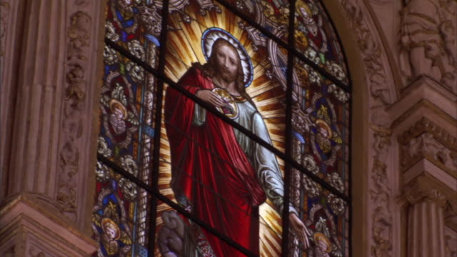 a stained glass window in the mosque-cathedral of cordoba depicts jesus christ. - mosque stock videos & royalty-free footage