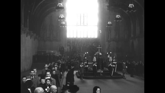 stained glass window in westminster hall with slow pan down to people filing past / nurses in uniform w pan to coffin candles and regalia / solitary... - stained clothes stock videos and b-roll footage