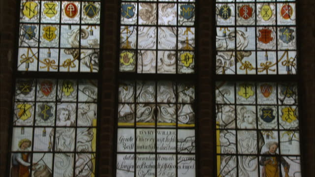 stained glass windows of a church in the netherlands - 人の姿点の映像素材/bロール