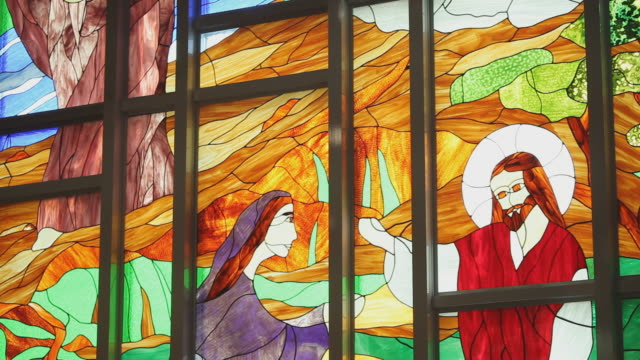 stained glass with religious connotation in a church - female likeness stock videos & royalty-free footage