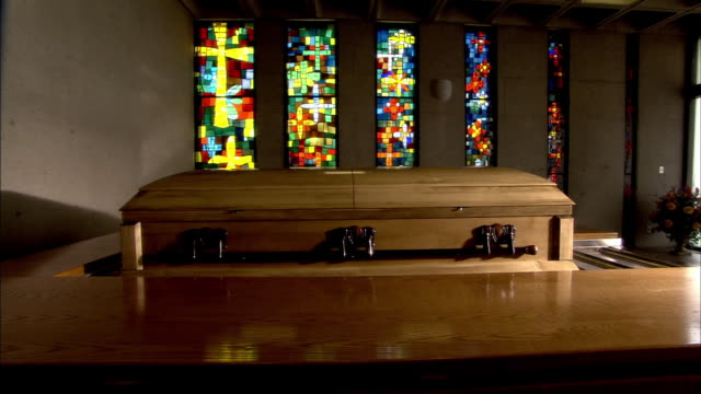 stained glasses and coffin in a church