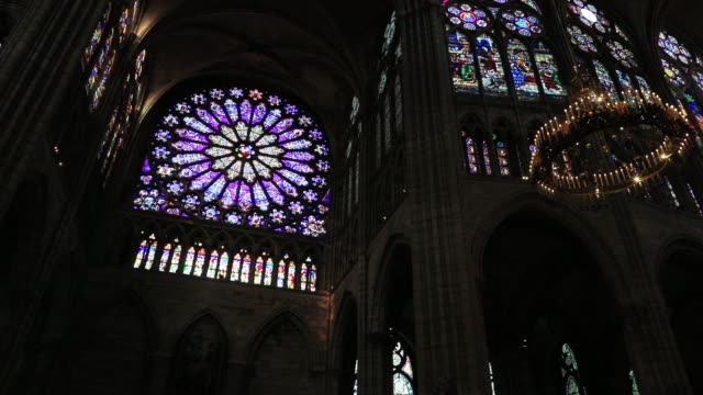 stained-glass windows at the basilica of saint-denis in the outskirts of paris on july 5, 2020 in saint denis, france. the church houses the remains... - cathedral stock videos & royalty-free footage