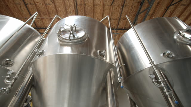 la ws ts stainless steel fermenting vessels in modern micro brewery / thousand palms, california, usa - beer alcohol stock videos & royalty-free footage