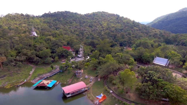vídeos de stock e filmes b-roll de stainless steel temple among green forest in remote area, aerial video - remote location