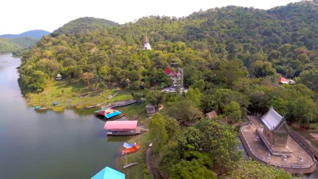 rostfritt stål tempel bland grön skog i avlägset område, antenn video - remote location bildbanksvideor och videomaterial från bakom kulisserna