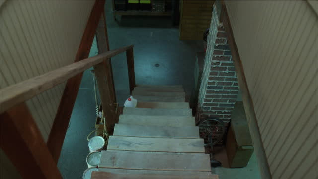 A staircase leads to a partially finished basement.