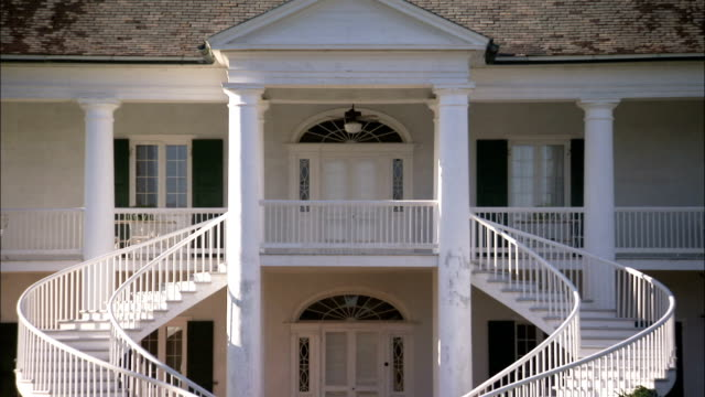 Staircases curve around the front door of the Evergreen Plantation house. Available in HD.