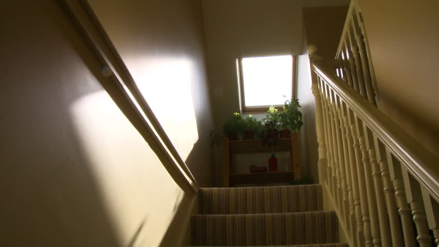 stairwell in a home - kommode stock-videos und b-roll-filmmaterial