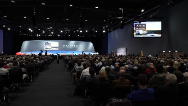 stakeholder listen to the speech of dieter zetsche, chairman of daimler ag, who speaks at the annual daimler ag shareholders meeting on may 22, 2019... - annual general meeting stock videos & royalty-free footage