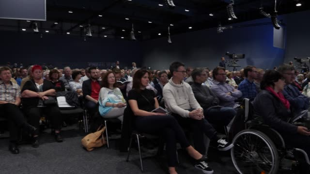 stakeholder listen to the speech of the chairman of the supervisory board of daimler ag, manfred bischoff, who speaks during the annual daimler ag... - annual general meeting stock videos & royalty-free footage