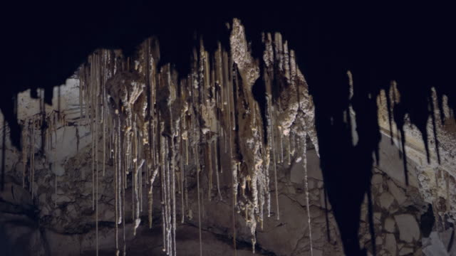 stalactites and stalagmites inside mysterious cave - limestone stock videos & royalty-free footage