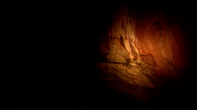 stalactites hang from cave ceilings. - calcium carbonate stock videos and b-roll footage
