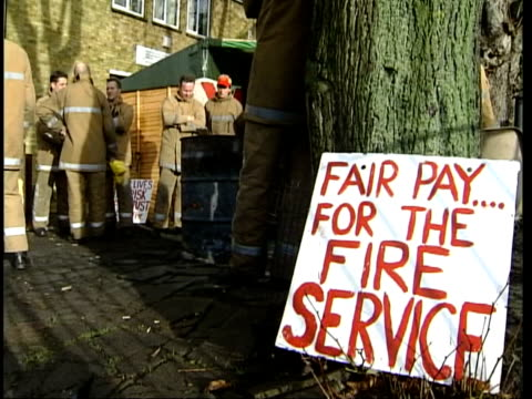 Stalemate/Tony Blair to make statement ITN Unknown location CMS Striking fireman sitting next brazier 'Fair pay for the fire service' sign propped...