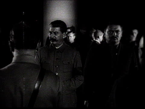 stalin attending kirov's funeral in moscow . mcu stalin and other leaders stand in the guard of honor : zhdanov standing near stalin, zhdanov,... - 1934 stock-videos und b-roll-filmmaterial