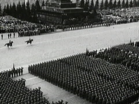 stalin on tribune - general view of soviet troops on red square - kliment voroshilov running the parade - soviet heavy tanks t-35 in line - soviet military stock videos & royalty-free footage