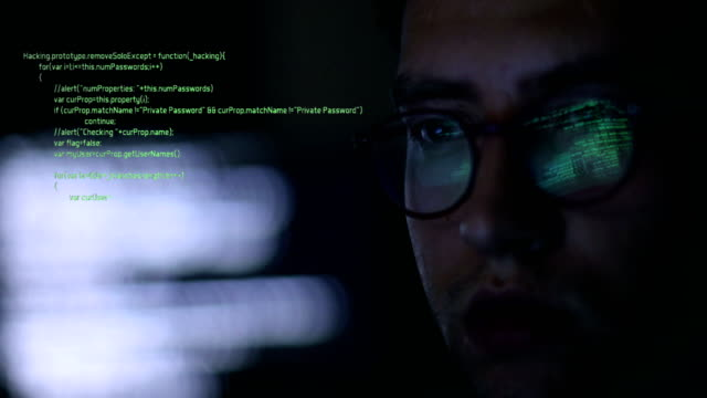 stalker, it man, businessman or hacker man working on computer - sicurezza di rete video stock e b–roll