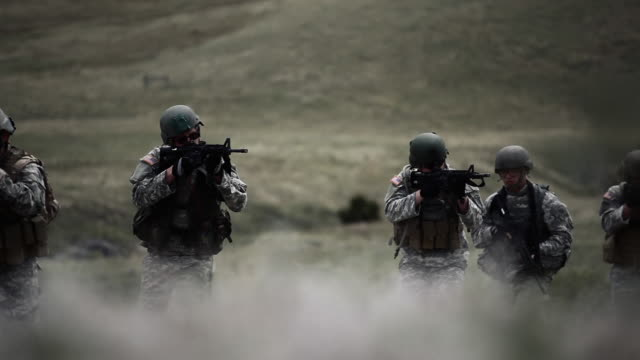 stalking soldiers ready their weapons - special forces stock videos & royalty-free footage