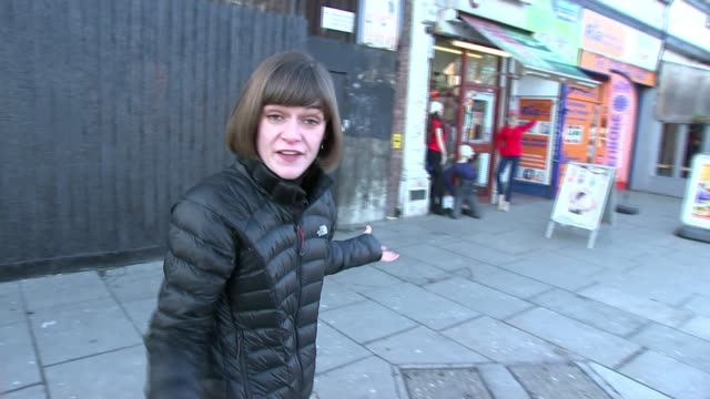 stallholders fighting to save latin american market in haringey; england: london: seven sisters: ext reporter to camera int vox pops cutaway various... - 画面切り替え カットアウェイ点の映像素材/bロール