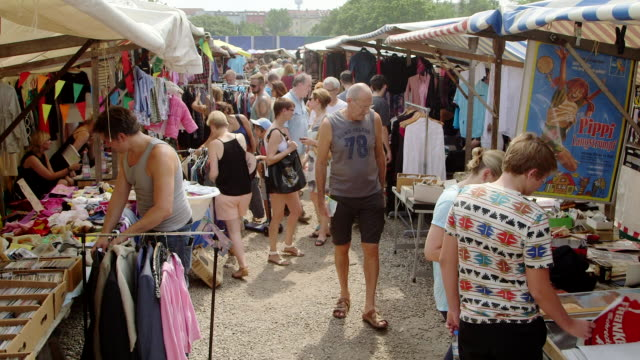 ws stalls and shoppers at mauerpark flea market - flea market stock videos & royalty-free footage