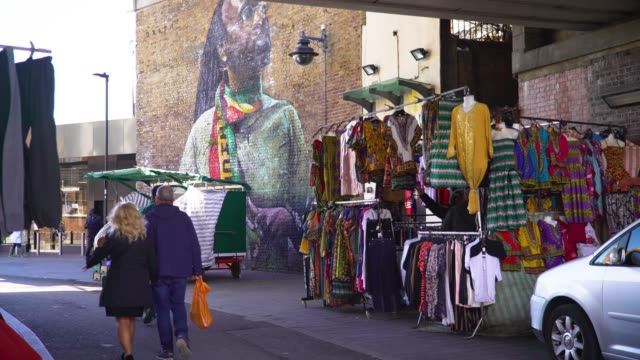 stalls on brixton market, london - multiculturalism stock videos & royalty-free footage