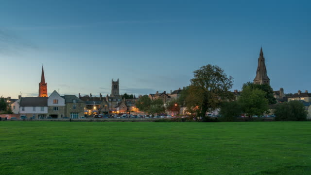 stamford town skyline in lincolnshire, england, 4k time-lapse (tilt-up) - lincolnshire stock videos & royalty-free footage