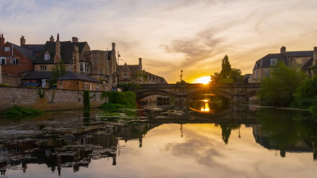 stamford town with river welland during sunrise in lincolnshire, england 4k time-lapse - column stock videos & royalty-free footage