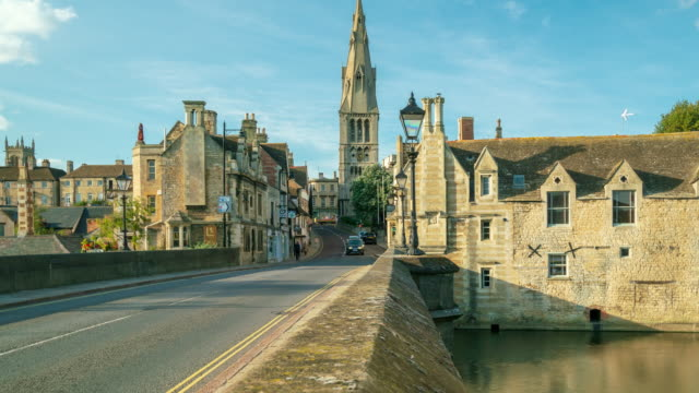 stamford town with river welland in lincolnshire, england 4k time-lapse (zoom-out) - england stock videos & royalty-free footage
