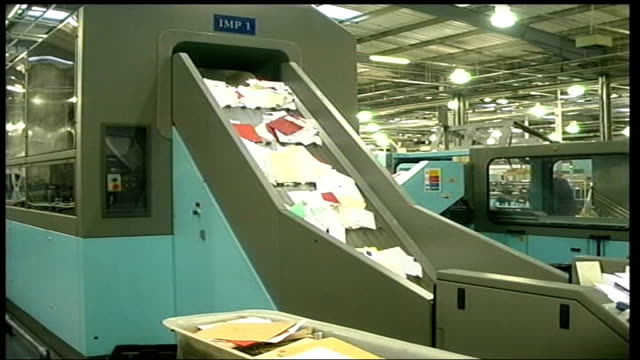 stamp auctioned for world record figure date letters along conveyor belt in postal sorting office - postal stamp stock videos and b-roll footage