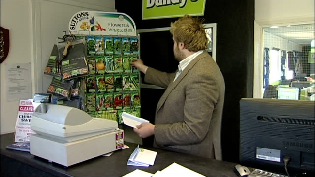 Stamp prices to rise by more than a third WALES Flintshire Deeside 'Dandy's Topsoil' sign on building TILT DOWN bags of soil INT **Bellamy interview...