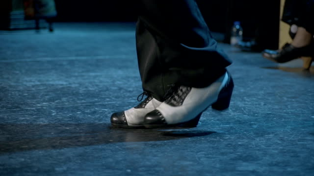 c/u stamping feet of professional flamenco dancer (man, live performance) - flooring stock videos & royalty-free footage