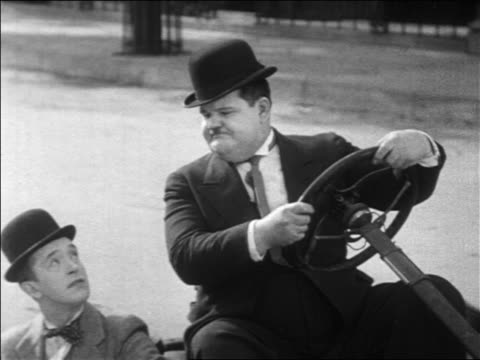 vidéos et rushes de stan laurel oliver hardy sitting in collapsed car arguing / feature - 1931