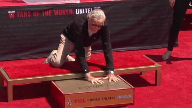 stan lee whose marvel superheroes have dominated popular culture for half a century is honored as he plunges his hands and feet into cement at... - tcl chinese theater stock-videos und b-roll-filmmaterial