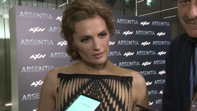 stana katic attends absentia madrid premiere and talks about her character best characteristics - stana katic stock videos and b-roll footage
