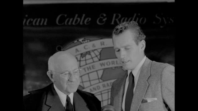 2 stand at microphone for press conference demille says ïchuckí should say something about a pilgrimage up mt sinai heston says moses was most... - cecil b. demille stock videos & royalty-free footage