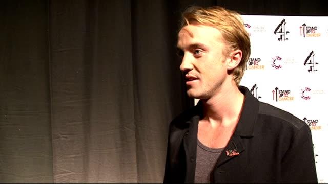 celebrity arrivals tom felton posing / interview sot - tom felton stock videos & royalty-free footage