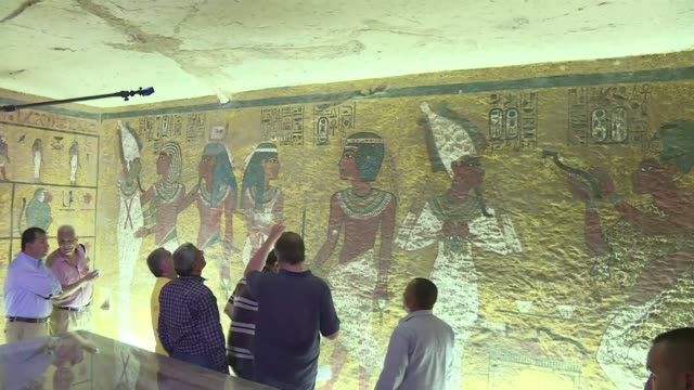 standing before the majestic gold ochre and white frescos of tutankhamun's tomb british archaeologist nicholas reeves on monday passionately defended... - archaeologist stock videos & royalty-free footage