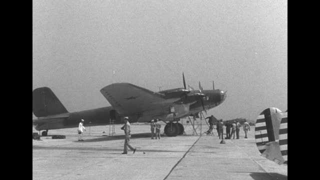 standing for photo opportunity on tarmac at airfield next to soviet plane from left to right us admiral ernest king commander in chief of us fleet... - cordell hull stock videos and b-roll footage