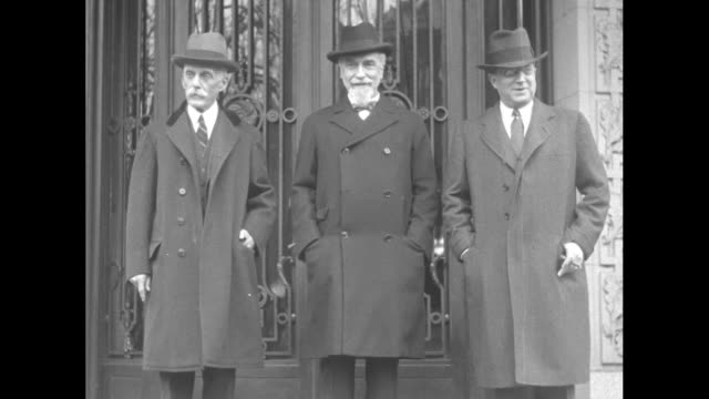 standing in front of entrance to the mccormick apartments and posing for photo opportunity from left to right us treasury secretary andrew mellon... - organised group stock videos & royalty-free footage